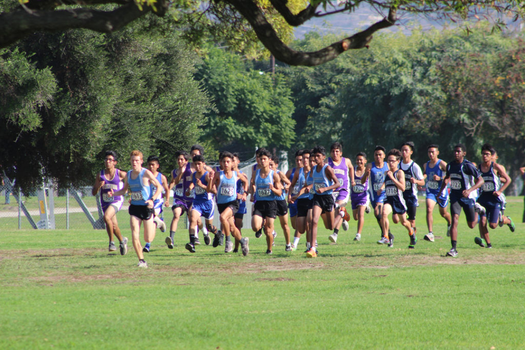 MVL Champ Noah Hibbard (second from left) leads the Varsity Boys off the line.